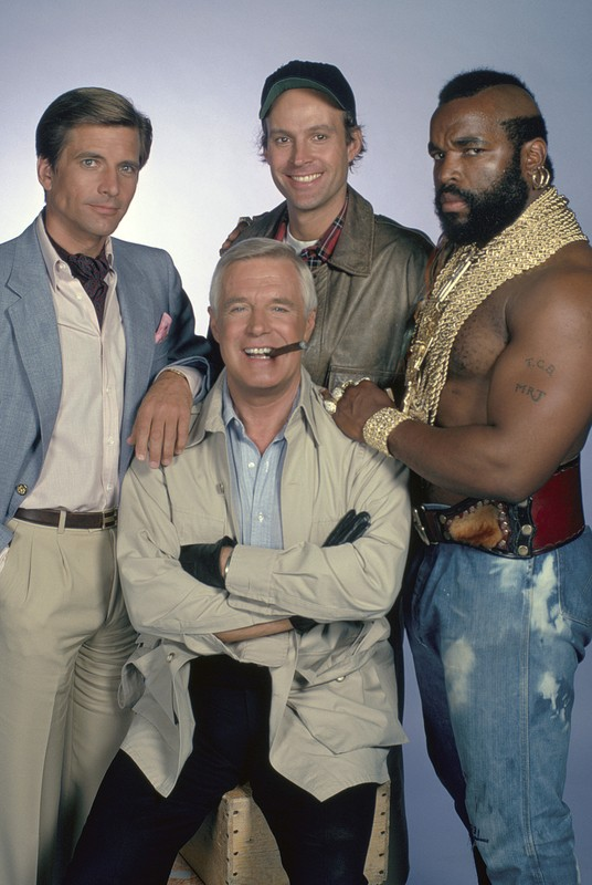 """THE A-TEAM -- Pictured: (clockwise from left) Dirk Benedict as Lt. Templeton """"Faceman"""" Peck #2, Dwight Schultz as Capt. H.M. """"Howling Mad"""" Murdock, Mr. T as Sgt. Bosco """"B.A."""" Baracus, George Peppard as Col. John """"Hannibal"""" Smith -- Photo by: Gary Null/NBCU Photo Bank"""